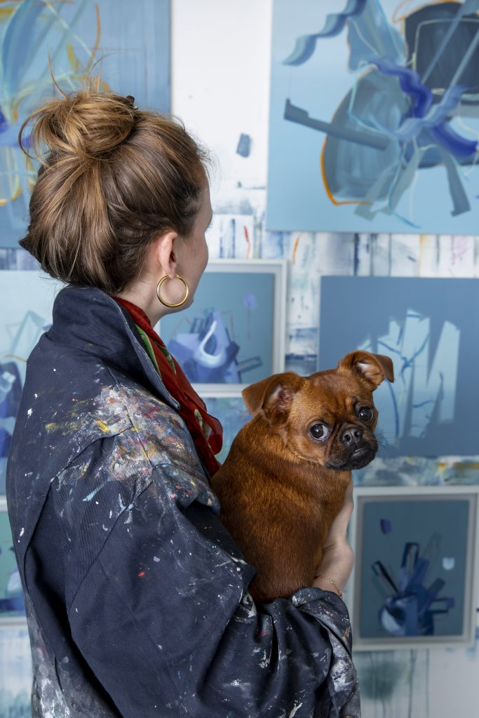 artist aisling drennan with her dog Nina (brussels griffon) at her London UK based studio
