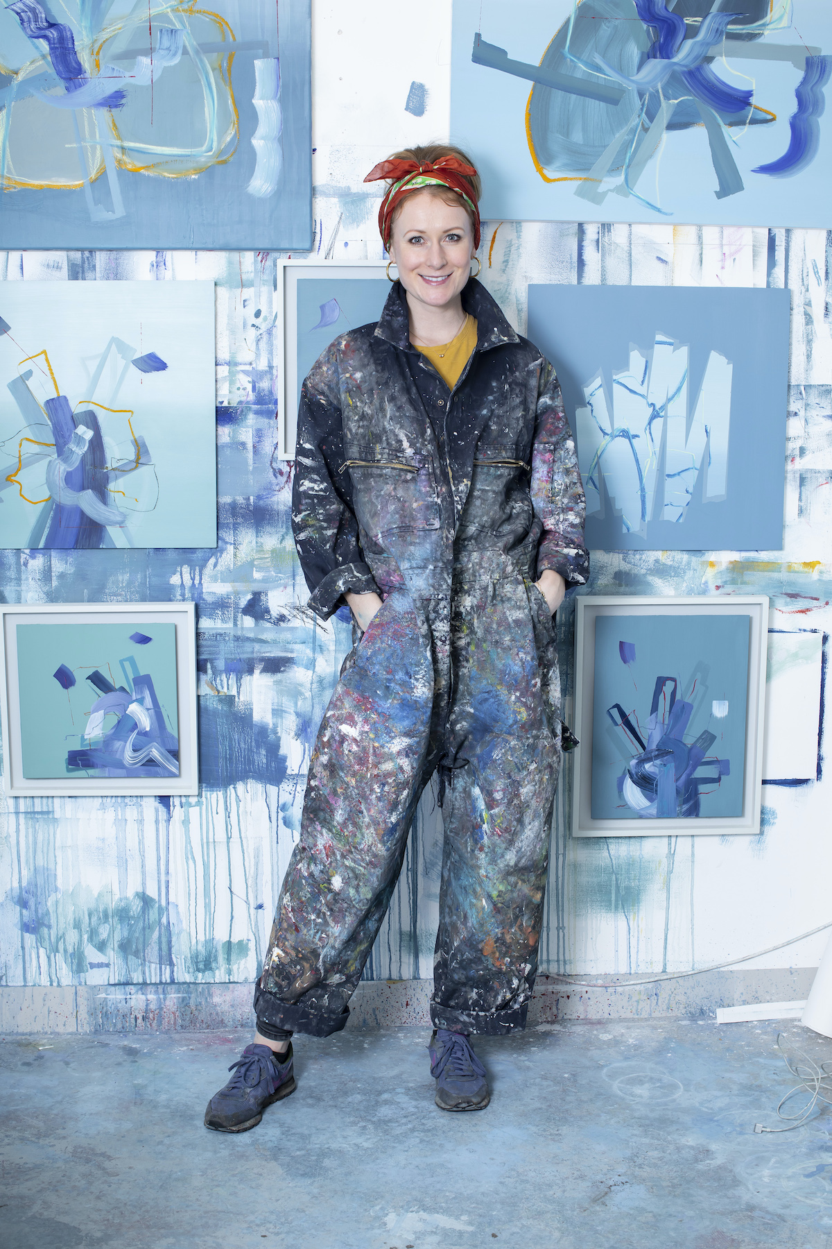 aisling drennan irish artist in her london studio. blue and green abstract paintings